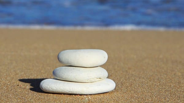 A stack of stones on a beach: Image by PublicDomainPictures from Pixabay