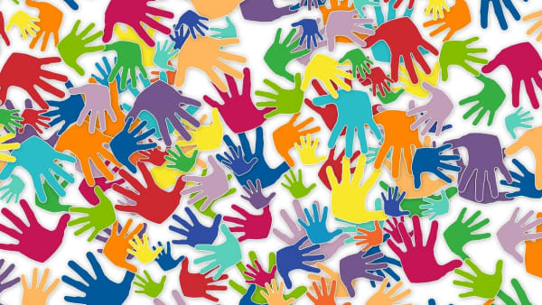 Lots of brightly coloured cartoon hands.
